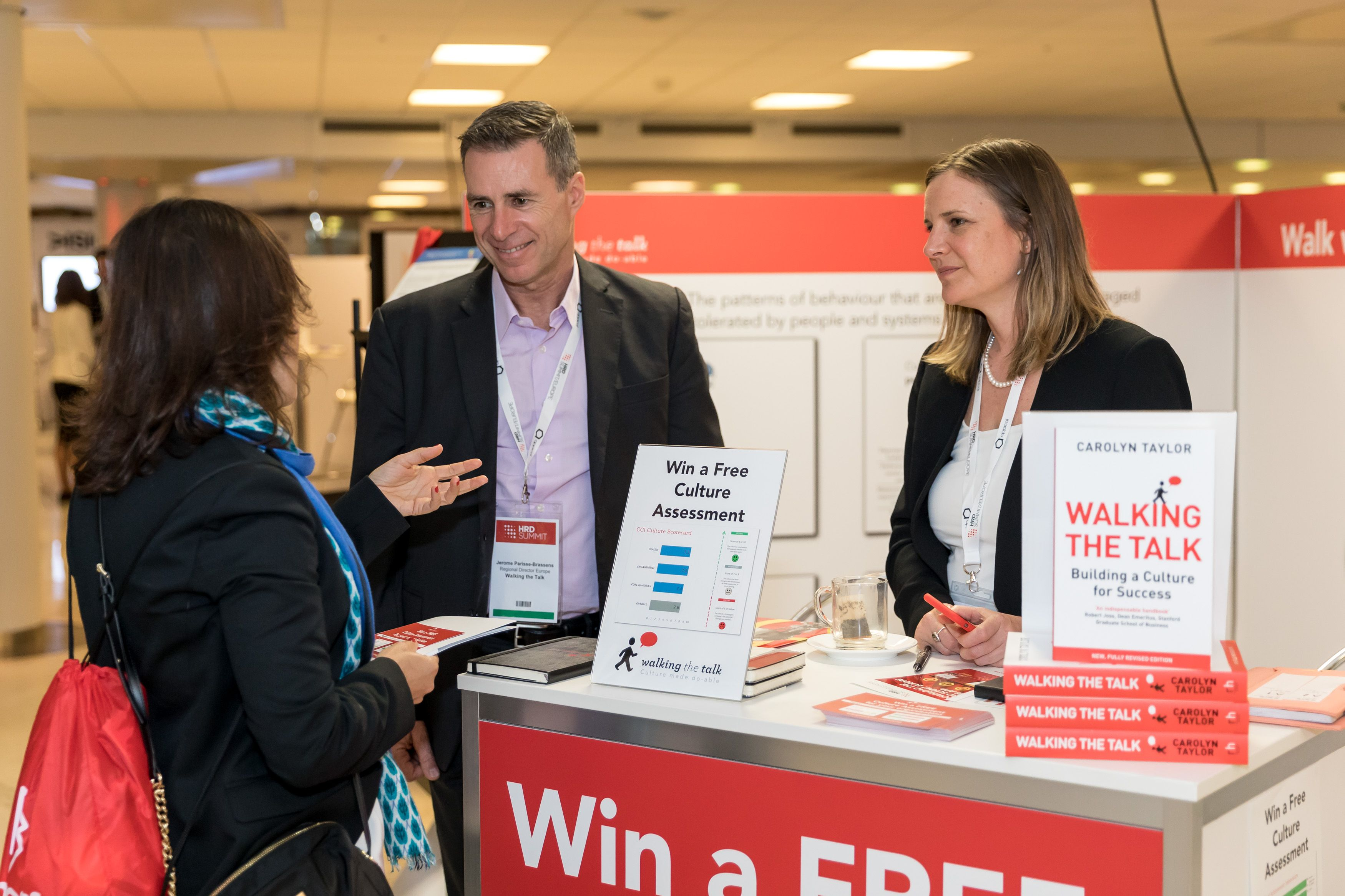 HRD-Summit-Europe-2018-Small-230 Walking the Talk Executive Director Jerome Parisse-Brassens and Senior Consultant Louise Taylor in discussion with a HRD Summit delegate.